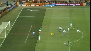 Picture clearly showing Tevez offside at the moment of Messi's pass.